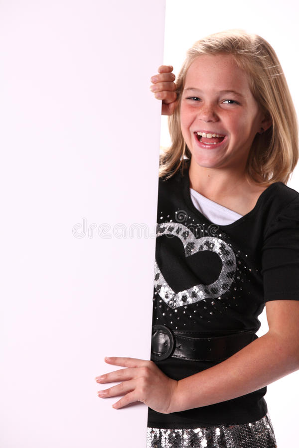 Free Positive Cheerful Happy 10 Year Old Girl With Sign Royalty Free Stock Images - 27727119
