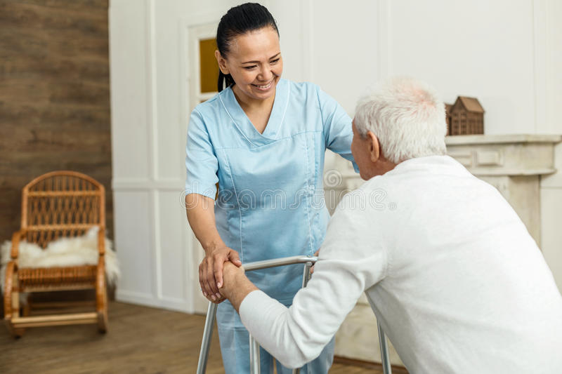 Positive cheerful woman smiling to her patient royalty free stock photo