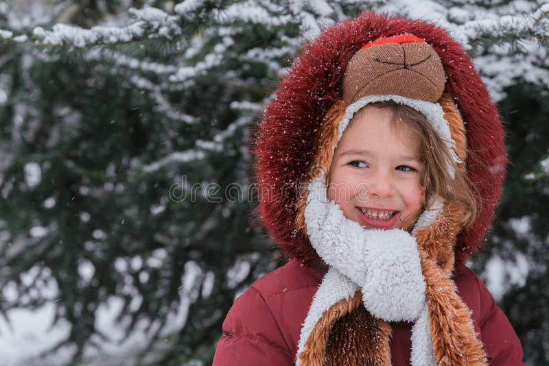Positive child portrait. With snow in background stock photography