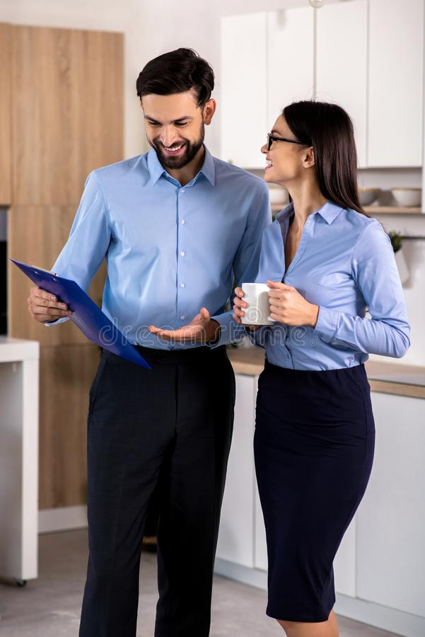 Positive colleagues discussing their ideas in the kitchen stock photography