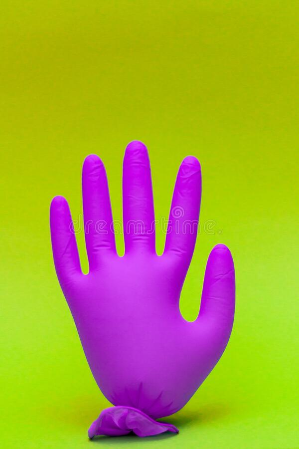 Positive concept. Pandemic is over. Bright gloves balloon hand. Copy space. Bye Bye coronavirus. Pop art.  royalty free stock photo