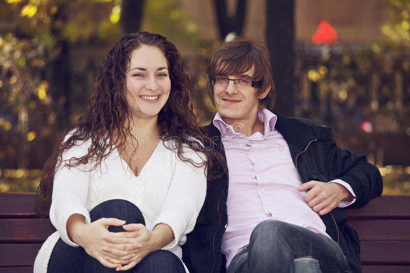 Positive couple on the bench royalty free stock images