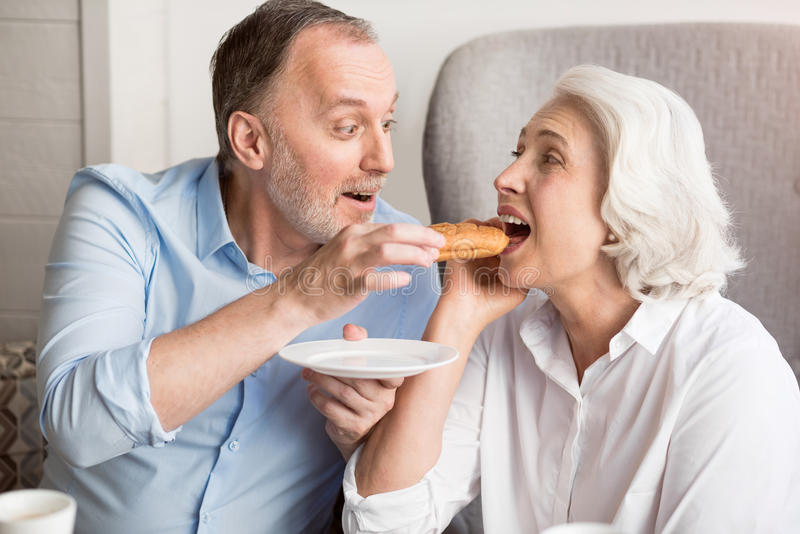 Positive couple resting in the cafe royalty free stock image