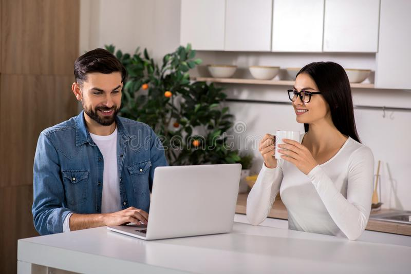 Positive couple resting in the kitchen royalty free stock photography