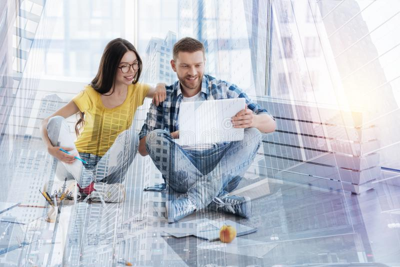 Positive delighted colleagues preparing project royalty free stock photo