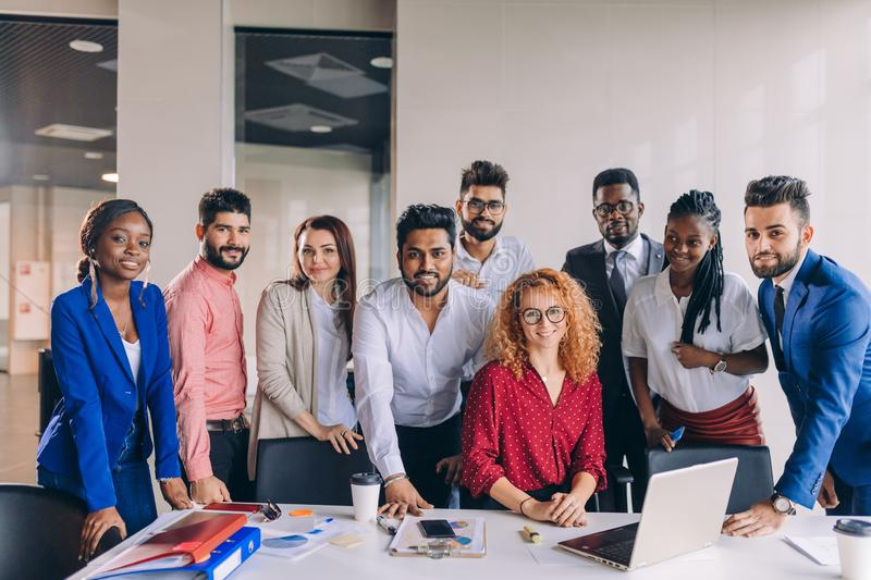 Positive diverse volunteers gathered in the office royalty free stock photography