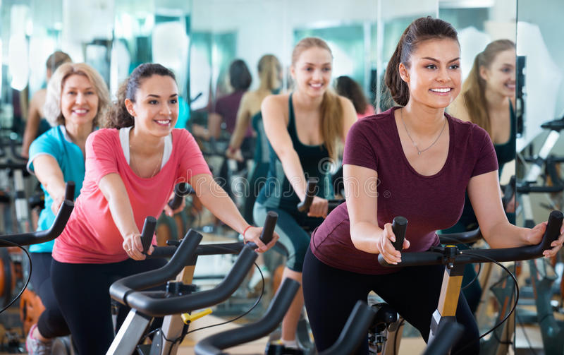Positive elderly and young women working out hard royalty free stock photo