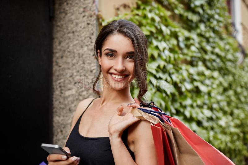 Positive emotions. Lifestyle concept. Close up portrait of beautiful joyful dark-haired caucasian woman in black shirt royalty free stock photo
