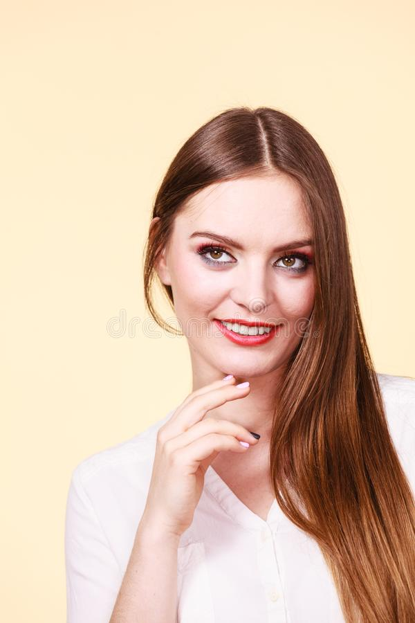 Smiling attractive woman with full makeup royalty free stock photography