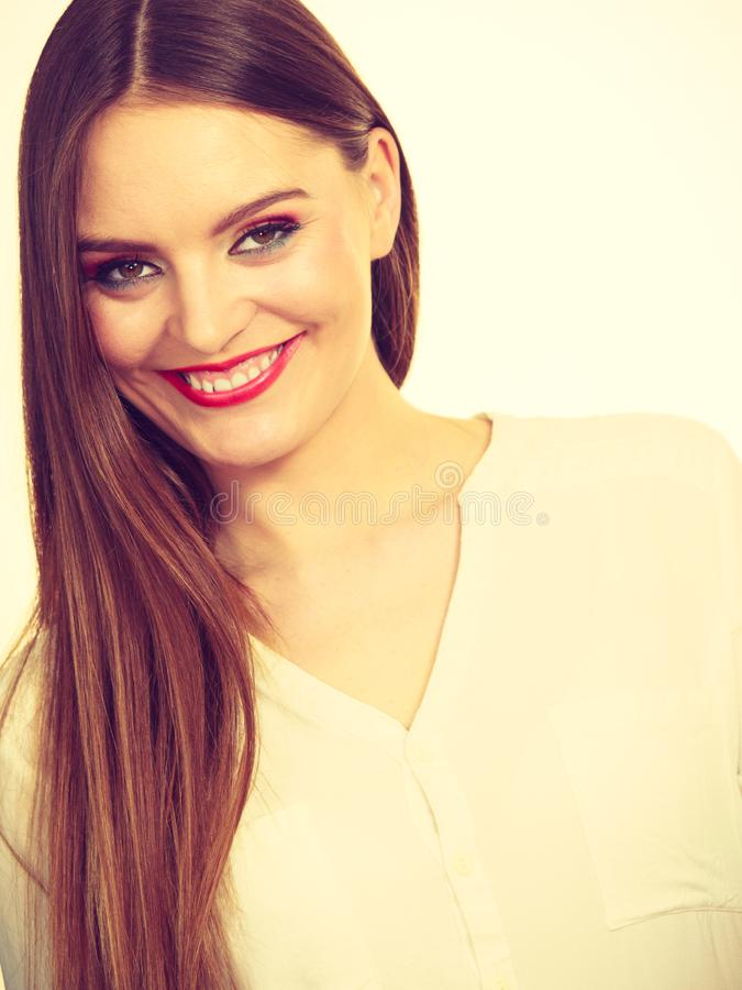 Smiling attractive woman with full makeup royalty free stock image