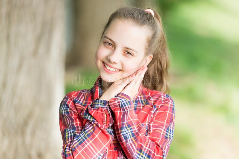 Positive emotions. Small girl relaxing in park. Little child enjoy walk park. Weekend time. Girl carefree child. Summer royalty free stock images