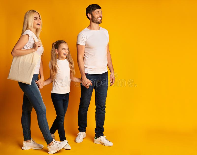 Positive Family Walking Holding Hands Spending Time Together On Yellow royalty free stock images