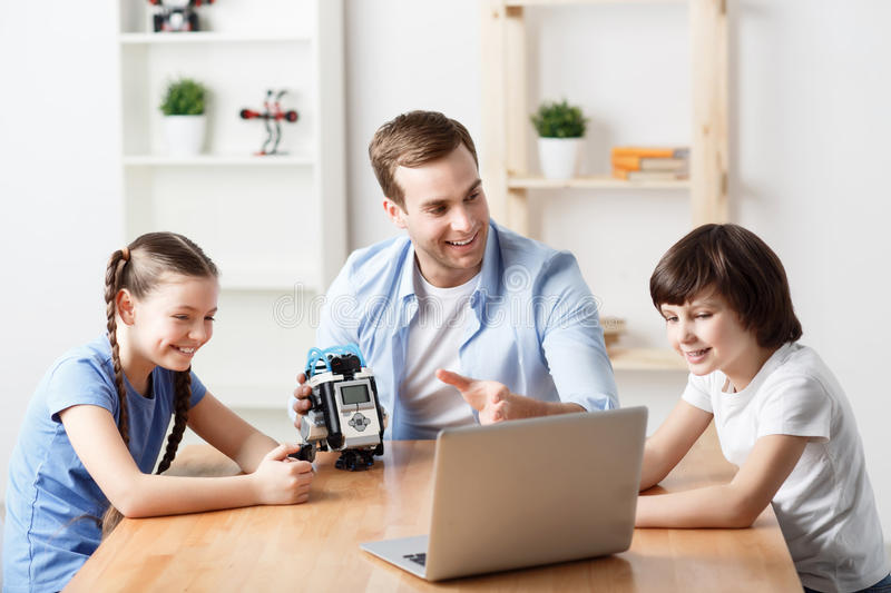 Positive father playing with kids royalty free stock photo