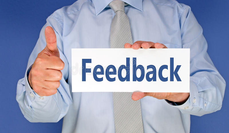 Positive feedback. Body of businessman with thumb up and feedback sign, blue background royalty free stock images