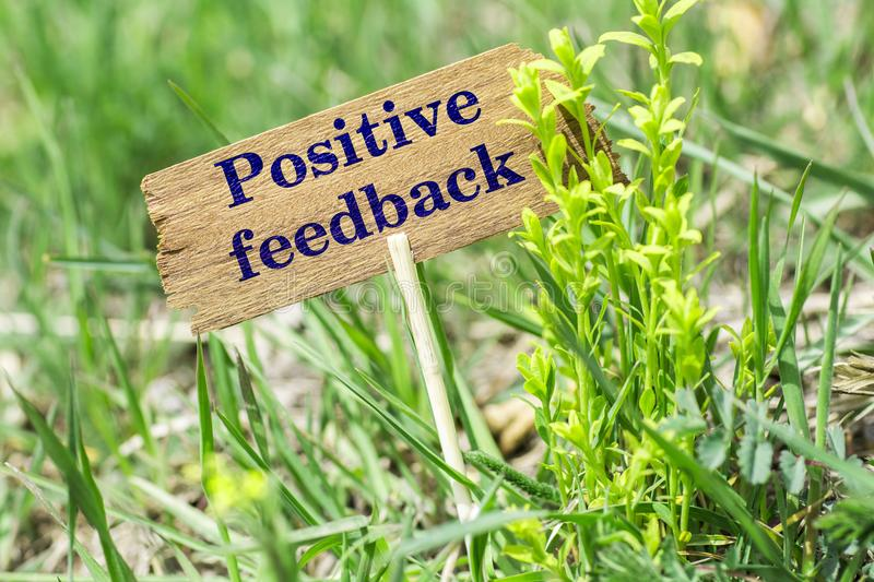 Positive feedback wooden sign stock photography