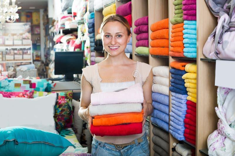Positive female customer choosing towels royalty free stock image