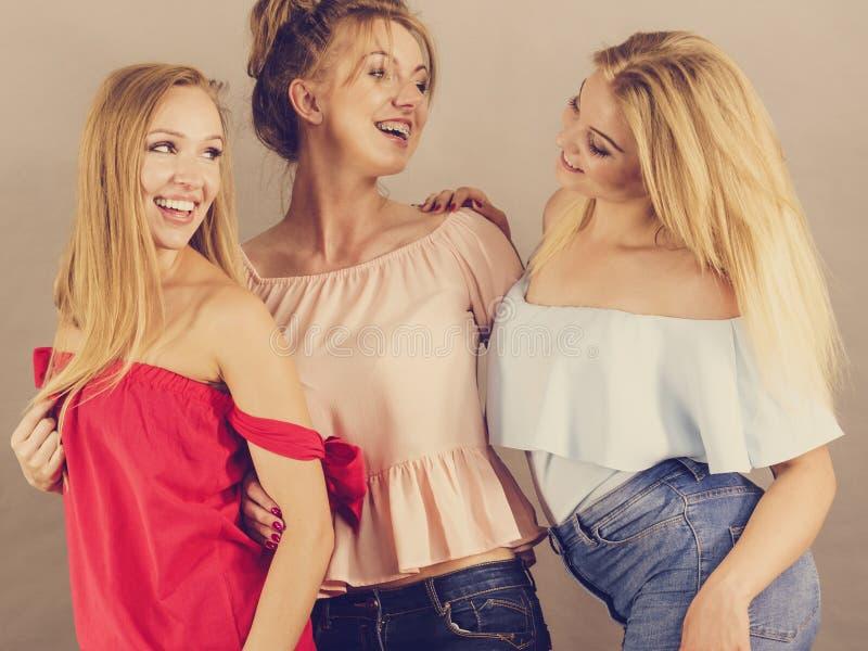 Positive female friends having fun stock photo