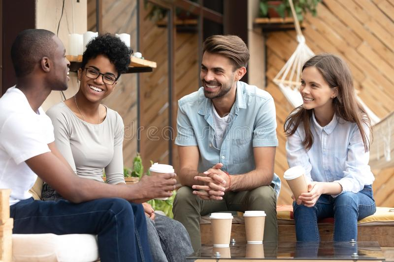 Positive friends talking sitting in coffee shop royalty free stock photo