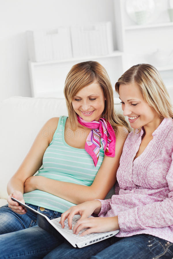 Positive Friends Using A Laptop Stock Photography
