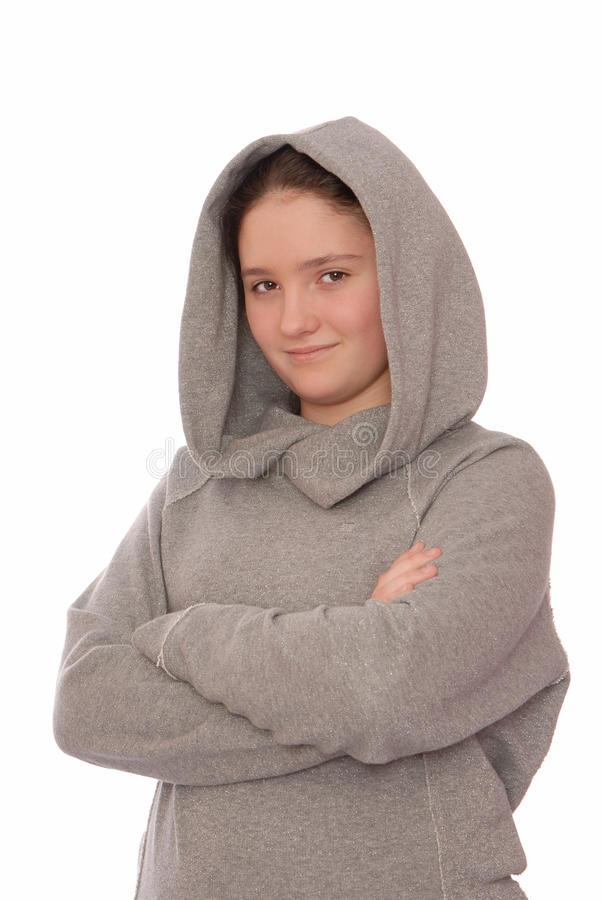 Positive girl is in grey hoodie. stock photography