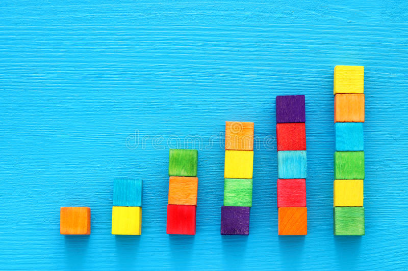 positive graph on wooden board, finance or education concept. royalty free stock photos
