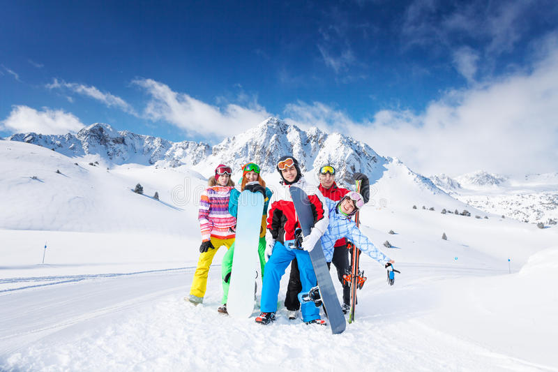 Positive group of 5 snowboarders royalty free stock photography