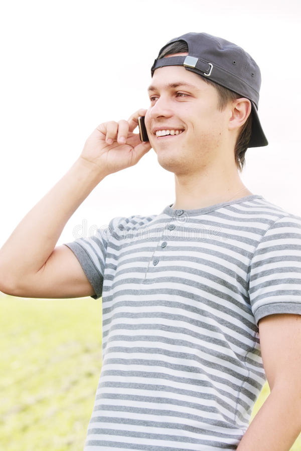 Download Positive guy with phone stock image. Image of phone, vertical - 12619137