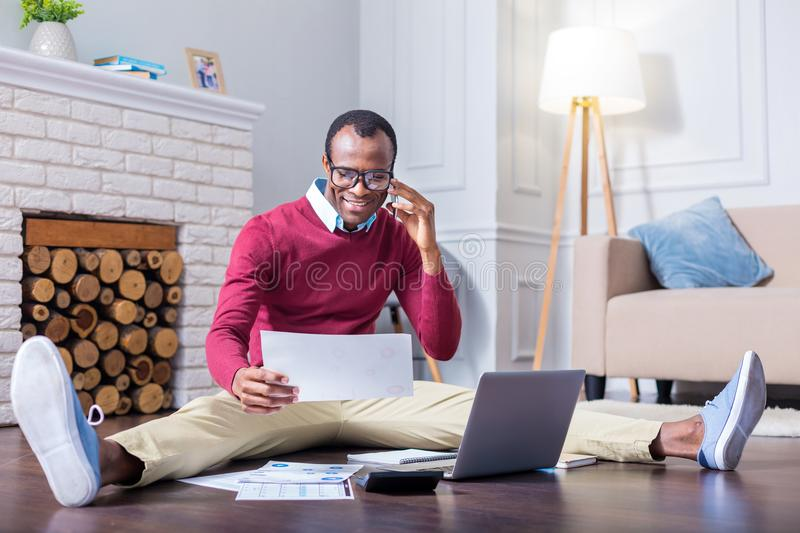 Download Positive Hard Working Man Making A Call Stock Photo - Image of domestic, lifestyle: 108861692