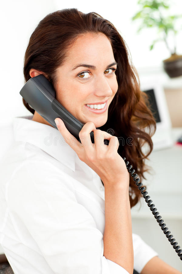Positive hispanic businesswoman talking on phone royalty free stock photos