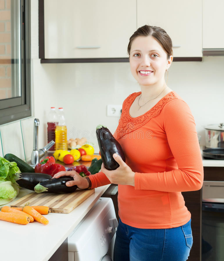 Download Positive Housewife Cooking Eggplants Stock Photo - Image: 30702332