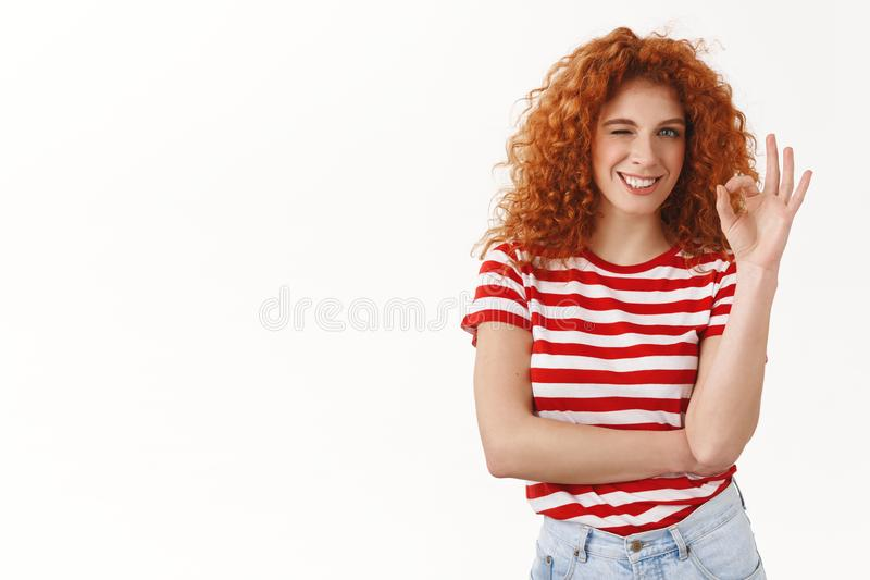 Only positive impressions after great vacation trip summer holiday. Attractive redhead lively girl show okay affirmative stock photos