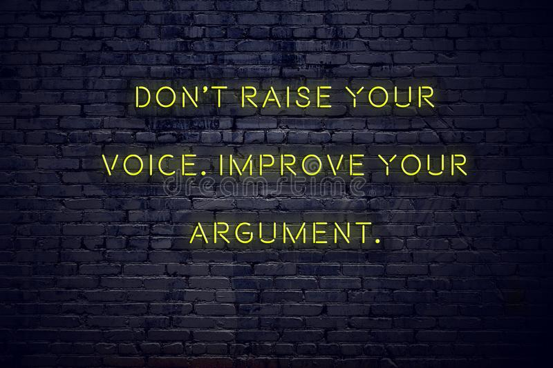 Positive inspiring quote on neon sign against brick wall dont raise your voice improve your argument royalty free illustration