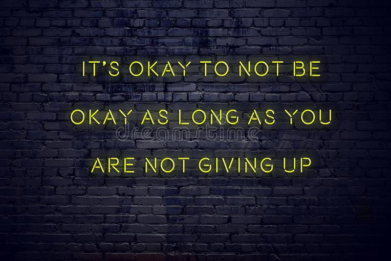 Positive inspiring quote on neon sign against brick wall its okay to not be okay as long as you are not giving up vector illustration