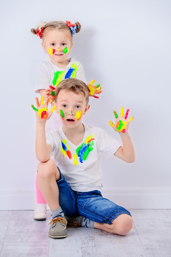 Positive kids with paints stock image