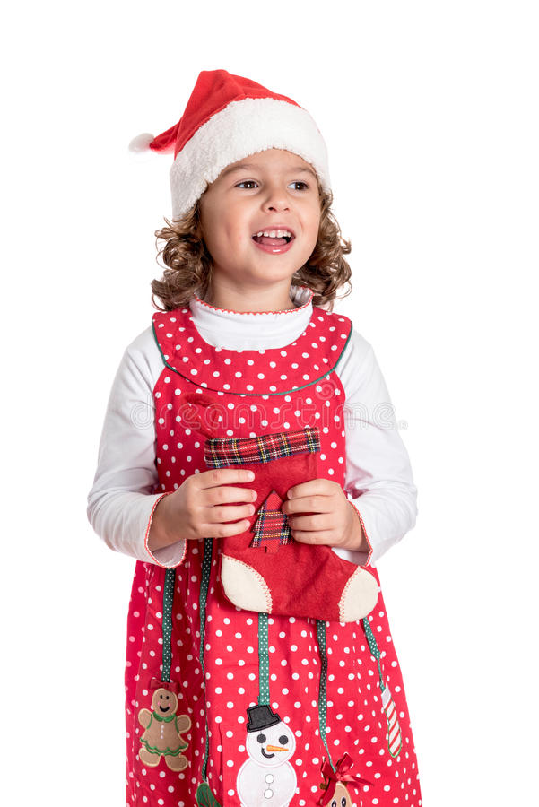 Positive little Santa. Portrait of positive child holding Christmas sock and hat,isolated on white background stock photo