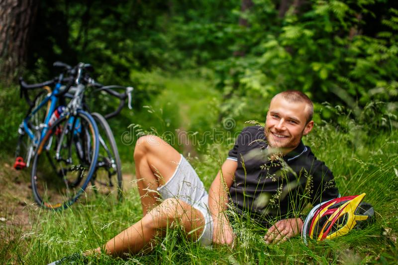 Positive male resting on a grass. stock photography