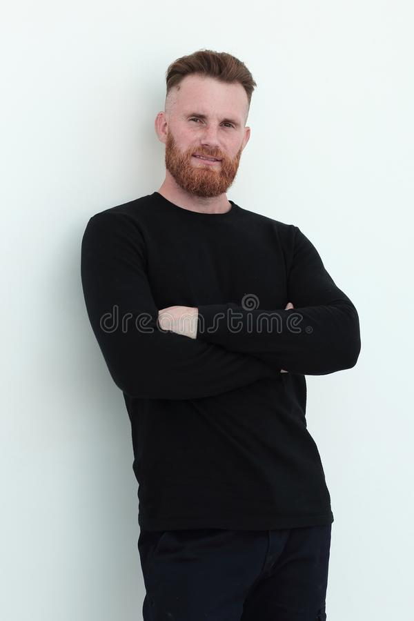 Positive man in a black sweater. isolated on white stock photo