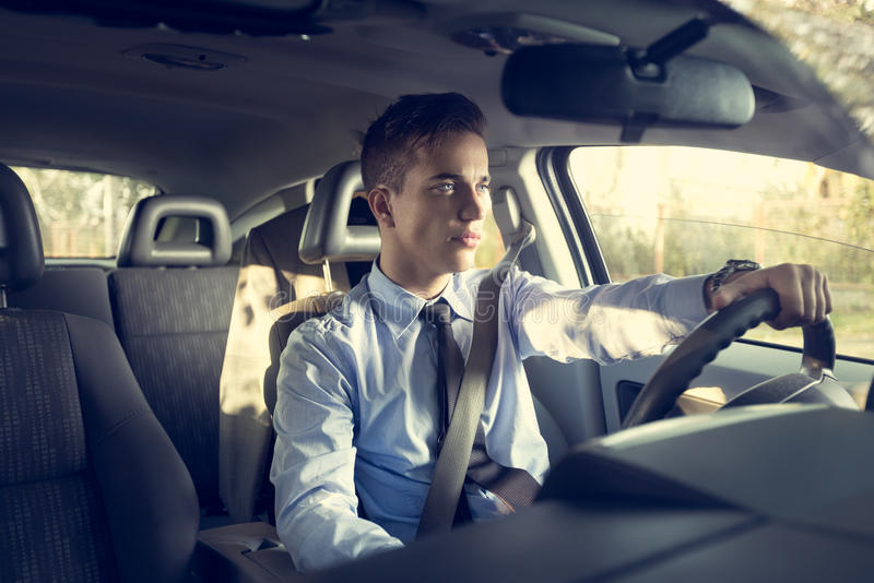 Positive man in car outdoor royalty free stock images