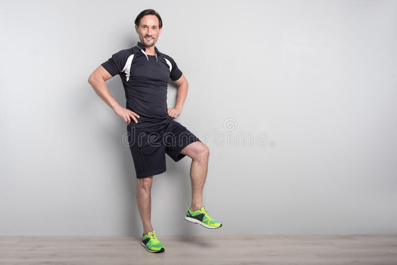 Positive man doing sport exercises royalty free stock photography