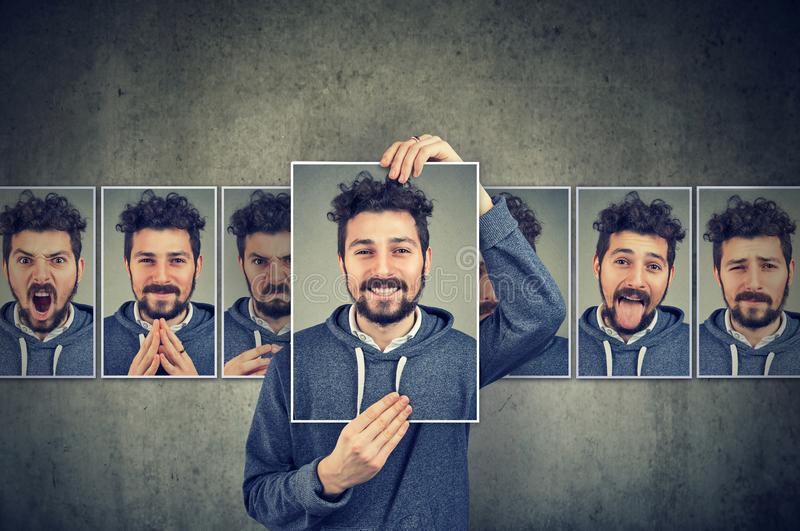 Positive masked man in glasses expressing different emotions. Positive masked young man in glasses expressing different emotions and face expressions royalty free stock photos