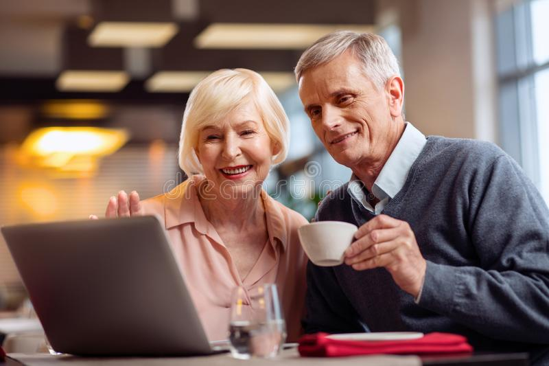 Positive mature couple calling daughter royalty free stock image