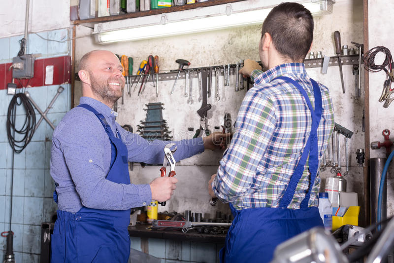 Positive mechanics at work. In a workshop stock photography