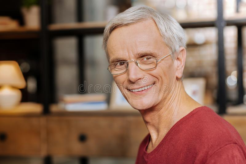 Portrait of a delighted nice man stock image