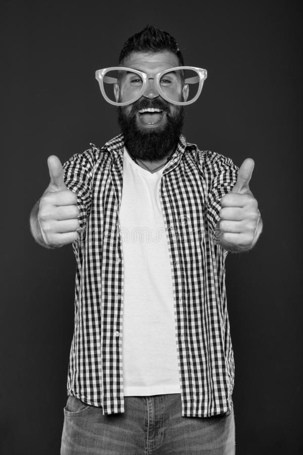 Positive mood. Positive psychology. Overcome life troubles with smile. Happiness and positive. Stay positive. Man brutal. Bearded hipster wear funny eyeglasses royalty free stock photos