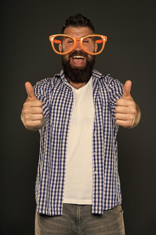 Positive mood. Positive psychology. Overcome life troubles with smile. Happiness and positive. Stay positive. Man brutal. Bearded hipster wear funny eyeglasses stock photos