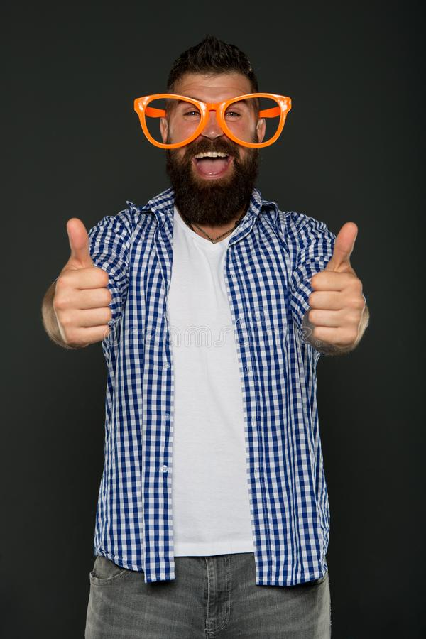 Positive mood. Positive psychology. Overcome life troubles with smile. Happiness and positive. Stay positive. Man brutal. Bearded hipster wear funny eyeglasses royalty free stock image