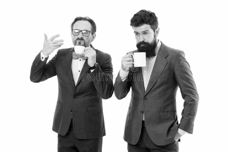 Positive morning. coffee break. Good morning. bearded men hold tea and coffee cup. businessmen in formal suit with drink. Business lunch. partners celebrate royalty free stock image