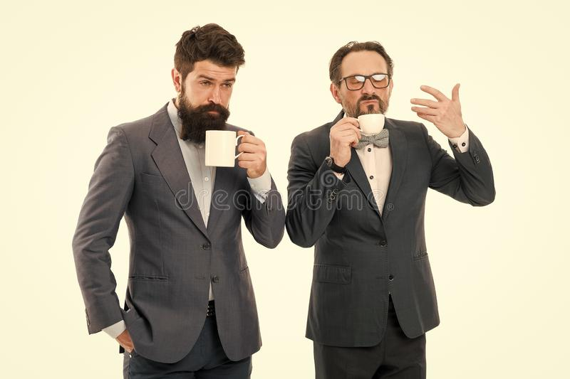 Positive morning. coffee break. Good morning. bearded men hold tea and coffee cup. businessmen in formal suit with drink. Business lunch. partners celebrate stock images