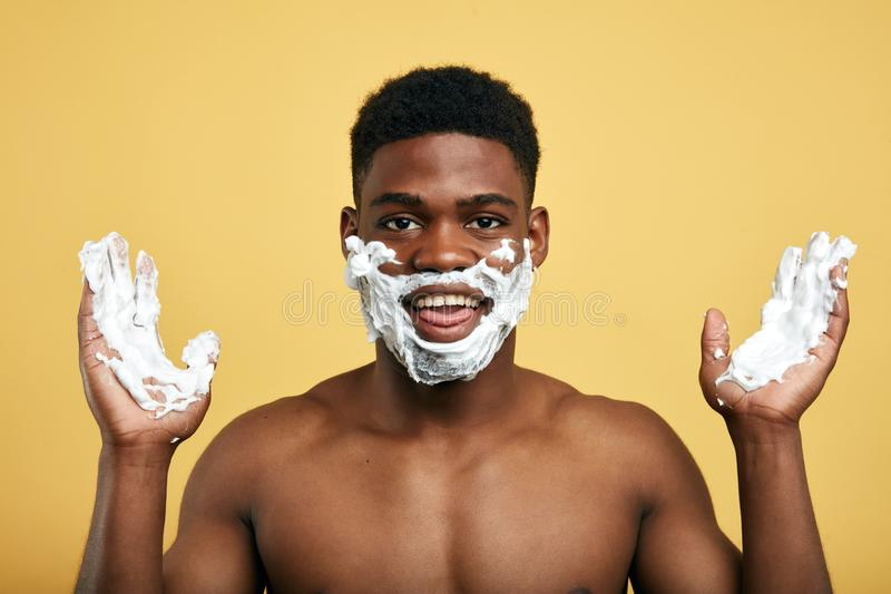 Positive pleasant man rejoicing at shaving in the morning. stock photo