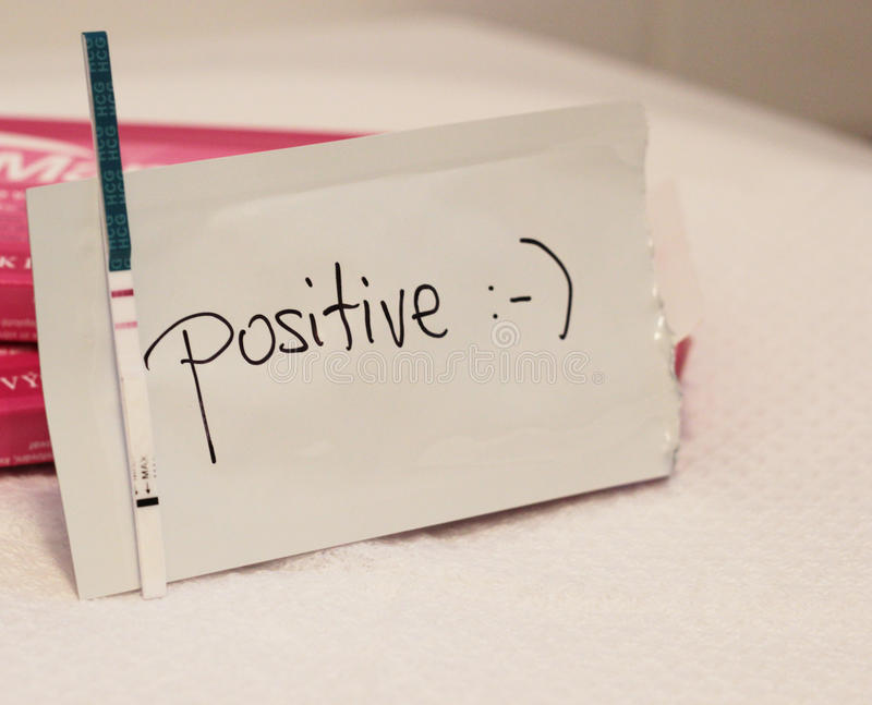 Positive pregnancy test. Text with smile royalty free stock photography